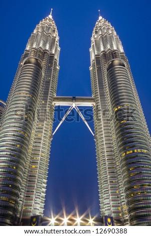 Petronas Towers in Kuala Lumpur Malaysia at night. - stock photo