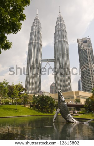 Petronas Towers in Kuala Lumpur view from park in daytime - stock photo