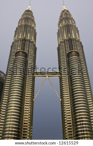 Petronas Towers Kuala Lumpur early evening with grey sky - stock photo