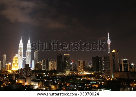 Petronas twin tower and KL tower at night - stock photo