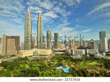 Petronas Twin Towers in Malaysia in Summer Sunny Day. Beautiful Urban View - stock photo