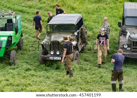 Petropavlovsk, Kazakhstan - JULY 24, 2016: off-road vehicle cars moving on the off road at competitions, Petropavlovsk, Kazakhstan. Joyful viewers.