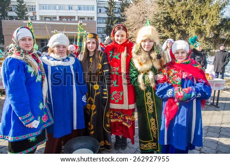 PETROPAVLOVSK, KAZAKHSTAN - MARCH 21, 2015: celebration of the new year on the solar calendar astronomical in Iranian and Turkic peoples. Women in international dresses