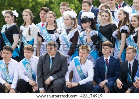 "Petropavlovsk, Kazakhstan - May 25, 2016: The solemn event (last bell). Last call for school holidays. ""Graduates 2016"" blue patch."