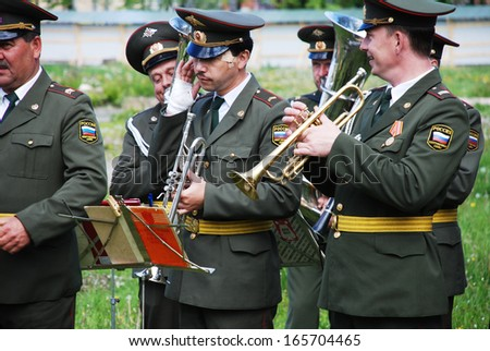 PETROZAVODSK, RUSSIA - JUNE 8: military band musicians perform on a city holiday on June 8, 2007 in Petrozavodsk, Russia