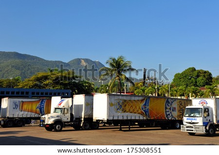 PEURTO PLATA, DOMINICAN REPUBLIC � JAN 22:  Brugal Rum was established in 1888 and is a very popular drink in the Dominican Republic as delivery trucks wait for shipment Jan 22, 2014 in Puerto Plata. - stock photo