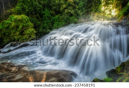 Pha Dokseaw - love - Rak jung, Waterfall in hill evergreen forest of Doi Inthanon, Chiang Mai, Thailand - stock photo