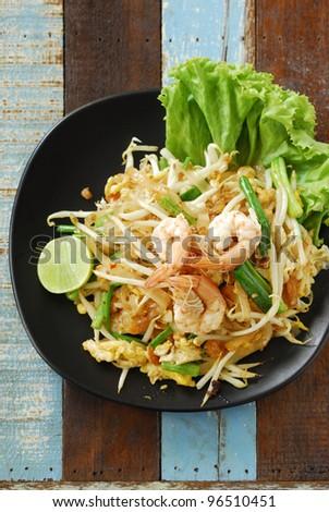 Phad Thai in black dish - stock photo