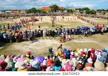 PHAN RANG, VIET NAM- OCT22: Amazing show at public stadium in Kate carnival, crowded panorama, group of Vietnamese woman in tradition clothing, fan dance in music, colorful dress,Vietnam, Oct22, 2014