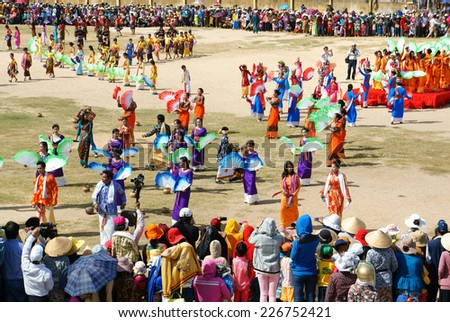 PHAN RANG, VIET NAM- OCT22: Show at public stadium in Kate carnival, crowded panorama, group of Vietnamese woman in tradition clothing, fan dance in music, colorful dress,Vietnam, Oct22, 2014