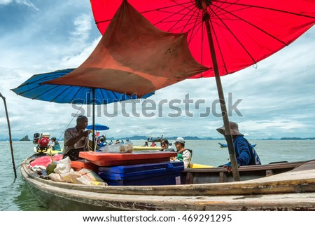 PHANG NGA BAY, THAILAND - JULY 19:  Floating food vendor in Phang Nga Bay national park area on July 19, 2016. The bay is famous for its limestone islands, including James Bond Island.