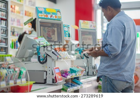 Phang Nga, 21 october 2014: 7-Eleven shop with cash desk at gas station in Phang Nga town, Phang Nga province, Thailand.