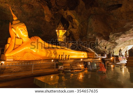 PHANG NGA, THAILAND - JULY 10: Wat Tham Suwan Khuha cave. The golden reclining Buddha is a tourist attraction in Phang Nga, Thailand on July. 10, 2016. - stock photo