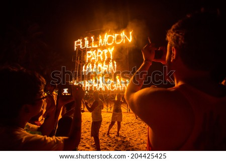 PHANGAN, THAILAND - MAY 15, 2014, There are about 10,000 people every month at this Phangan beach Full moon party, on May 15, 2014 in Koh Phangan , Thailand . - stock photo