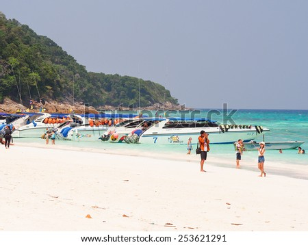 PHANGNGA-FEB 1: Tourists at the beautiful beach of Tachai island in Phang-Nag, Thailand on February 1st, 2015. Tachai island has a beautiful dive site and is included in the Similan National Park. - stock photo