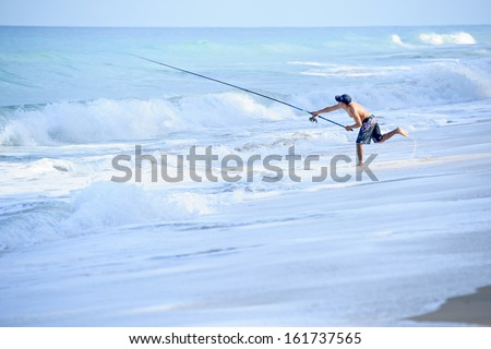 PHANGNGA PROVINCE, THAILAND - May 20: an unidentified fisherman is casting his line and tying hook for fishing in the ocean May 20, 2012 in Phangnga Province, Thailand.