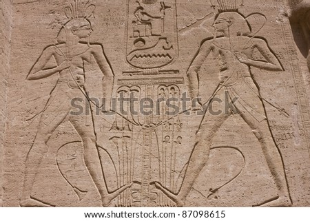 Pharaoh Ramses II's peace treaty with the Hittites shown in an engraving in the King's temple in Abu Simbel, Egypt - stock photo