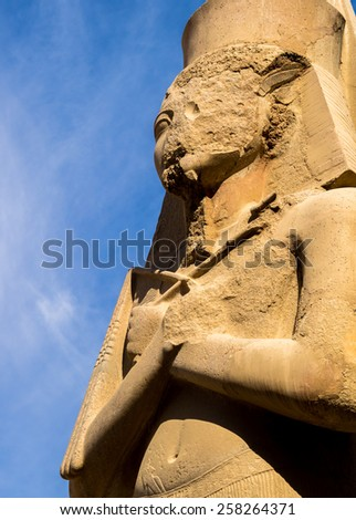 Pharaoh statue at Karnak Temple in Egypt. Luxor - ancient architecture of the Egypt civilization. Egyptian culture - travel on landmark of the ancient archeology. - stock photo