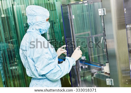 pharmaceutical factory woman worker in front of production line at pharmacy industry manufacture factory - stock photo