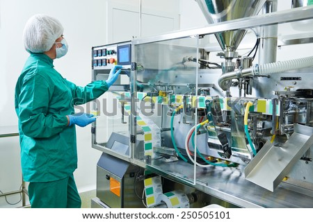 pharmaceutical factory woman worker operating production line at pharmacy industry manufacture factory - stock photo