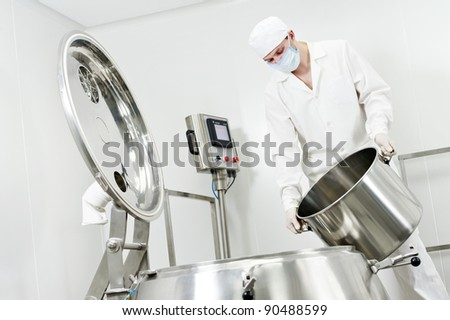 pharmaceutical factory worker at pharmacy industry manufacture - stock photo