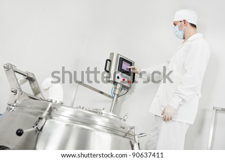 pharmaceutical factory worker at pharmacy industry manufacture with granulator - stock photo