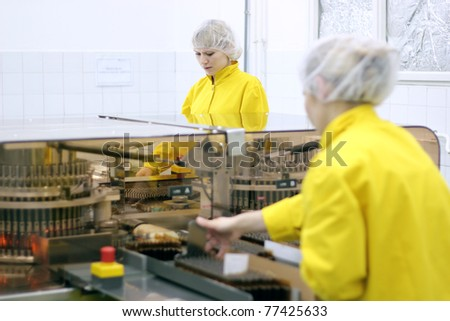 Pharmaceutical Manufacturing. Medicine Production. Automatic optical inspection machine, inspects vials and ampules for particulates in liquid and container defects. Selective focus. - stock photo