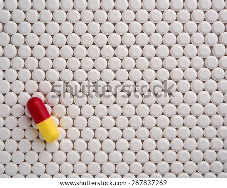 Pharmaceutical research. White pills background - stock photo