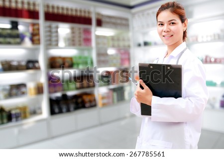 pharmacist chemist and medical doctor woman asia with stethoscope and clipboard checking medicine cabinet and pharmacy drugstore .  - stock photo