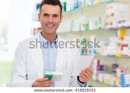 Pharmacist filling prescription in pharmacy - stock photo