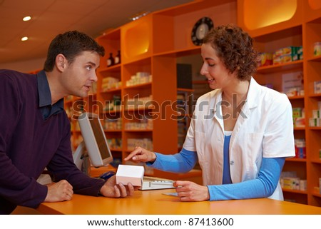 Pharmacist giving medical advice about medication to customer