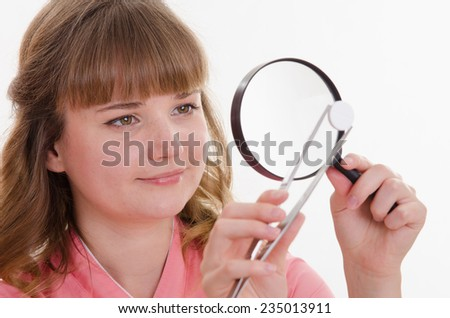 pharmacist is considering a tablet under magnifying glass