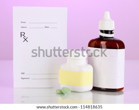 Pharmacist prescription with drops and pills isolated on purple - stock photo