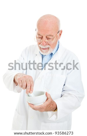 Pharmacist uses a mortar and pestle to mix medicine.  Isolated on white. - stock photo