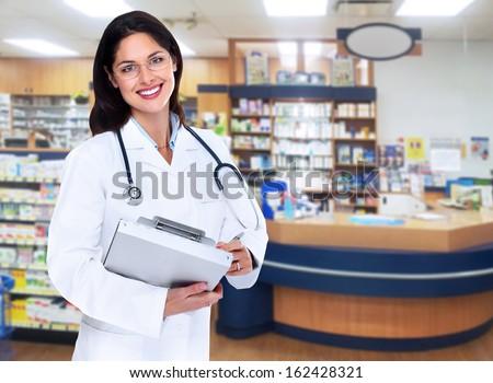 Pharmacist woman. Health care background. - stock photo