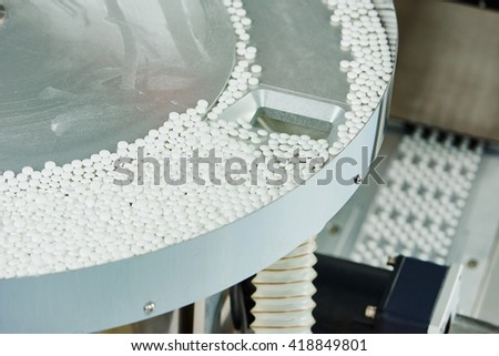 pharmacy medicine pill production background - stock photo