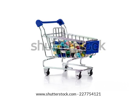 Pharmacy medicine. Shopping cart with pills and medical supplies