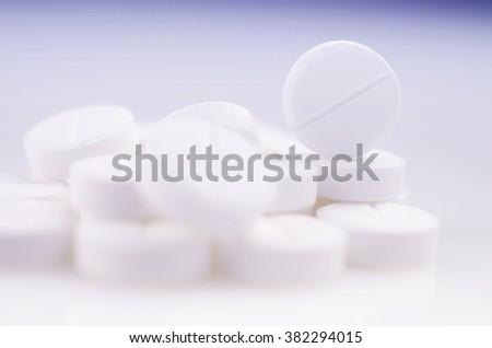 Pharmacy theme,  white  medicine tablets antibiotic pills. - stock photo