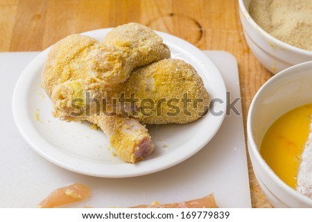 phases of fried chicken making with raw meat (flour, yolk, crumble) - stock photo
