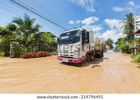 PHAYAO, THAILAND - SEPTEMBER 2: Heavy flooding from rain in Phayao on September 2, 2014 in Phayao, Thailand. - stock photo