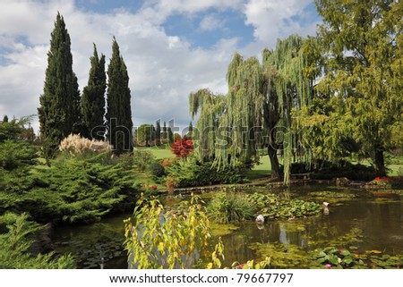 Phenomenally beautiful park-garden Sigurta. Shallow pond, trees and flowers. Northern Italy - stock photo