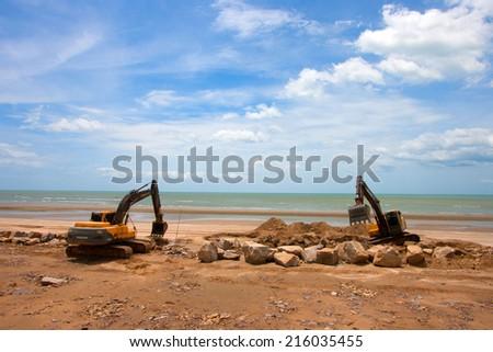 Phetchaburi, THAILAND - JULY 27 : excavator machine doing earthmoving work at sand quarry  27 July 2014. - stock photo