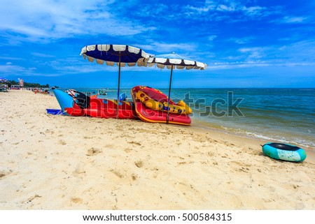 Phetchaburi, Thailand - October 9, 2016: Local swim ring with umbrella on the beach sea with blue sky in Thailand