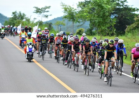 PHETCHABURI, THAILAND - SEPTEMBER 18, 2016 : Cyclists from different teams competing. In  Lrt  Century Super ; Kaengkrachan Racing Open Class at Kaengkrachan , Phetchaburi, Thailand