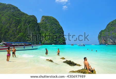 PHI PHI ISLANDS, THAILAND - APRIL 14: Unidentified people visit the bay with white sand beach on April 14, 2013 in Phi Phi Islands, Thailand.