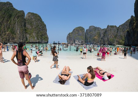 PHI PHI ISLANDS, THAILAND - CIRCA FEBRUARY, 2015: Tourists relax on the beach of Maya Bay on Phi Phi Leh island. It starred the movie The Beach with the actor Leonardo DiCaprio. Taken with a fisheye - stock photo