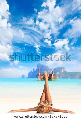 Phi PhiWoman on the beach on Ko Phi Phi island in Thailand - stock photo