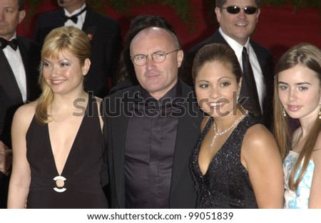 PHIL COLLINS & family at the 76th Annual Academy Awards in Hollywood. February 29, 2004