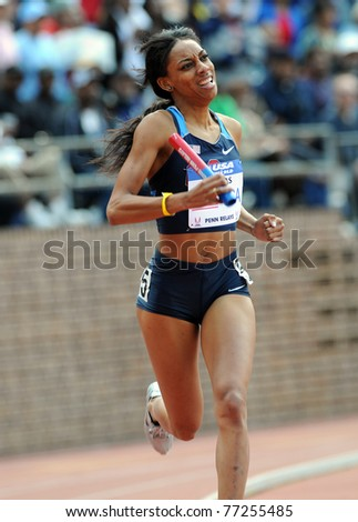 PHILADEDLPHIA - APRIL 30: Latavia Thomas from the USA comes around the turn on the anchor leg of the Olympic Development Sprint Medley Relay at the 117th Penn Relays April 30, 2011 in Philadelphia. - stock photo