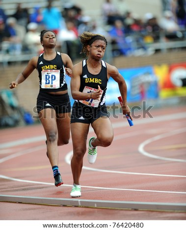 PHILADELPHIA - APRIL 28: Britney Foreman (r) from UMBC sprints for the finish as the anchor of a 4x100 heat at the 117th Penn Relays on April 28, 2011 in Philadelphia, PA